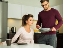 Couple on a kitchen at home Royalty Free Stock Photo