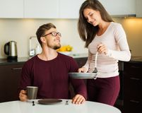 Couple on a kitchen at home Royalty Free Stock Images