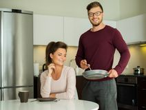 Couple on a kitchen at home Royalty Free Stock Photography