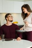 Couple on a kitchen at home Stock Image