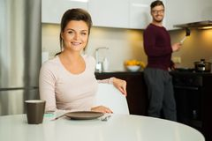 Couple on a kitchen at home Stock Photos