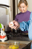 Couple in Kitchen Making Breakfast - vertical Stock Image
