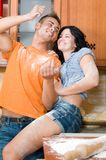 Couple in the kitchen playing with flour Royalty Free Stock Images