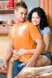 Couple in the kitchen playing with flour Stock Images