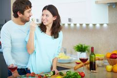 Couple in the kitchen Stock Photos