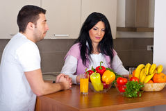 Couple in kitchen preparing food Stock Photo