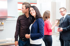 Couple in kitchen in store showroom Stock Photo