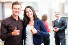 Couple in kitchen in store showroom Stock Image