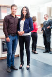 Couple in kitchen in store showroom Royalty Free Stock Photo