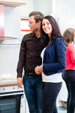 Couple in kitchen in store showroom Stock Photos