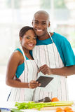 Couple kitchen tablet Royalty Free Stock Photography