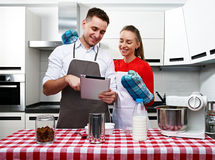 Couple at kitchen with tablet pc Royalty Free Stock Images