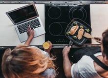 Couple on kitchen stock photo