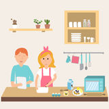 Couple in the kitchen using electronic tablet for cooking. Stock Photos