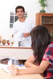 Couple in the kitchen Stock Photography