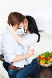 Couple at kitchen Stock Images