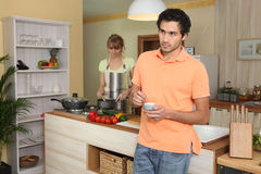 Couple in a kitchen Stock Photos