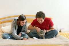 Couple with a kitten Royalty Free Stock Image
