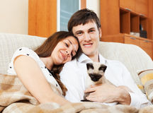 Couple with kitten in home interior Royalty Free Stock Photo