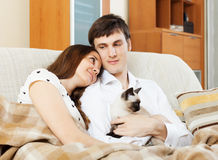 Couple with kitten Stock Images