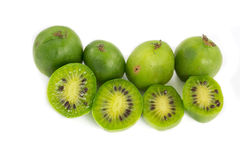 Couple of kiwi berries on white Stock Photos