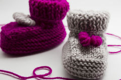 Couple knitted bootees to newborn Royalty Free Stock Photo