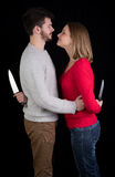 Couple with knives Royalty Free Stock Image