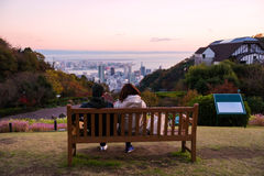 Couple at Kobe mountain for cityscape view Royalty Free Stock Images