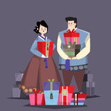 Couple in Korean traditional costume with holiday gifts Royalty Free Stock Image