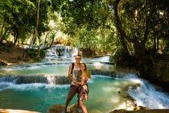 Couple on Kuang Si waterfall Stock Photography