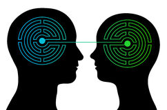 Couple with labyrinth brains communicate. Head silhouettes of a couple with a labyrinth inside their heads showing the complexity of the human brain and emotions Royalty Free Stock Photos