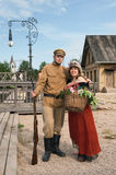 Couple of lady and soldier in retro style picture Royalty Free Stock Photos