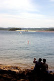 Couple by the lake. A loving couple enjoying watching the boats on the lake Royalty Free Stock Photography