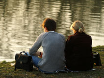 Couple on a lake. Yound couple sitting near a lake Stock Images