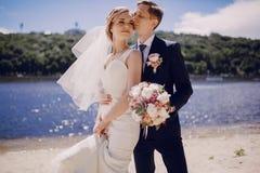 Couple on the lake beach Royalty Free Stock Photos