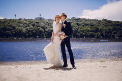 Couple on the lake beach Royalty Free Stock Images