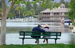 Couple by the Lake - Contempla Royalty Free Stock Images