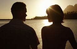 Couple By Lake Enjoying Sunset Royalty Free Stock Photography