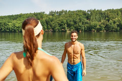 Couple at a lake on their summer holidays Royalty Free Stock Image