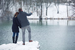 Couple at a lake in winter Royalty Free Stock Photos