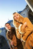 Couple in lambskin coats. Attractive couple in lambskin coats Royalty Free Stock Images