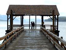 Couple on the landing stage Royalty Free Stock Photography