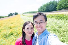 Couple with landscape in Furano stock photos