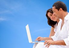 Couple with a laptop Royalty Free Stock Photo