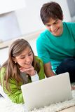 Couple with a laptop Stock Images