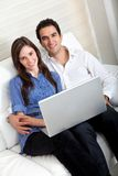 Couple with a laptop Royalty Free Stock Image