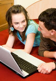 Couple with laptop. Young couple with laptop at home Royalty Free Stock Photo