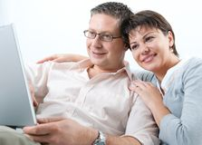 Couple on laptop Royalty Free Stock Photo