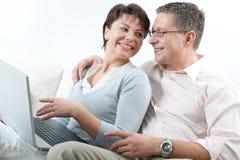 Couple on laptop Royalty Free Stock Image