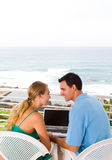 Couple with laptop Stock Photo